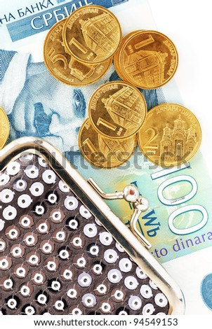 various serbian dinars coins over hundred banknote and silver purse