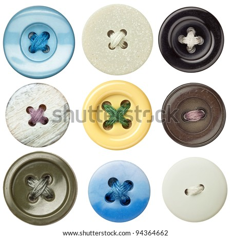 Various sewing buttons with a thread. - stock photo