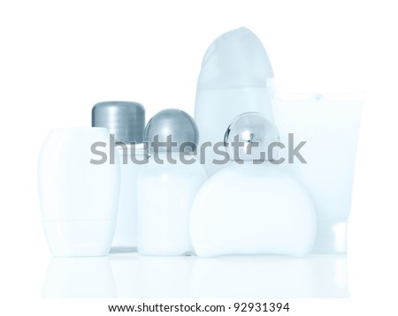 Various shampoo and lotion bottles. Blue tone. All on white background.