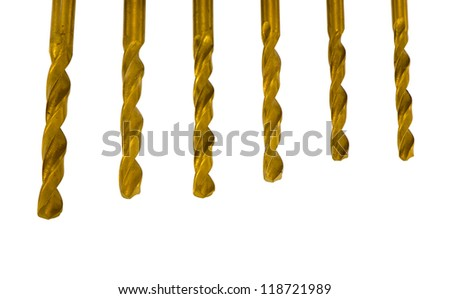 Various size golden drill bits isolated on white background - stock photo