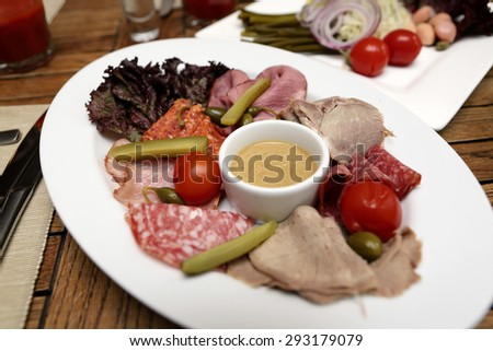 Various sliced meat on the white plate
