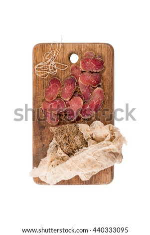 Various sliced meats on wooden serving board. Ham, pork or beef. Preparing for dinner. Selective focus - stock photo