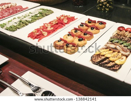 Various snacks in expensive hotel restaurant - stock photo