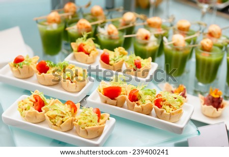 Various snacks on glass platter, banquet food - stock photo