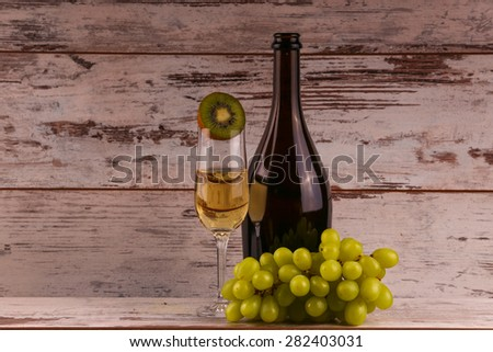 Various sorts of fruits, grapes and glass of the white wine - stock photo