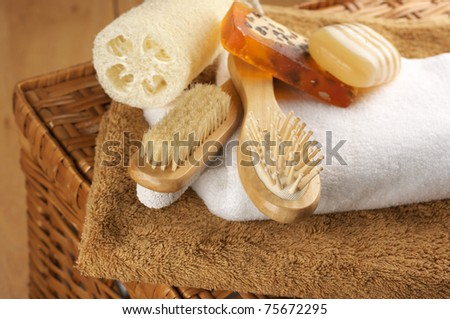 Various SPA accessories on wicker basket. - stock photo