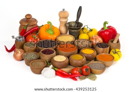 various spices and herbs in wooden bowl on white background - stock photo