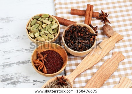 Various spices and herbs on table close up - stock photo