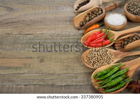Various spices and seasonings on a wooden background