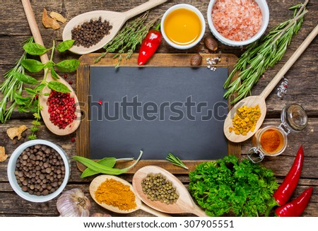 Various spices and Vintage blackboard with copyspace - stock photo
