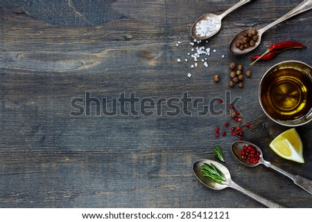 Various Spices. Herbs and spices selection - old metal spoons and rustic wooden background. Cooking, food or health concept. - stock photo