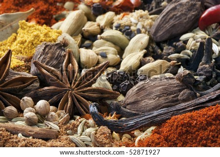 Various spices in full-frame.  Focus on star anise. - stock photo