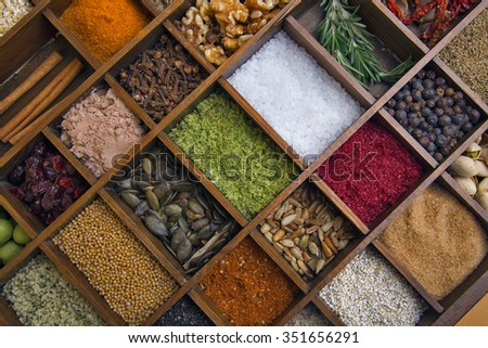 Various spices in wooden box - stock photo