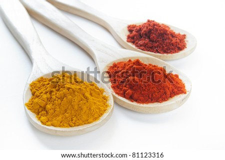 Various spices in wooden spoons - stock photo
