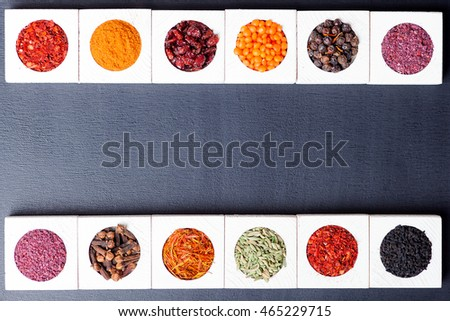 Various spices on black wooden background