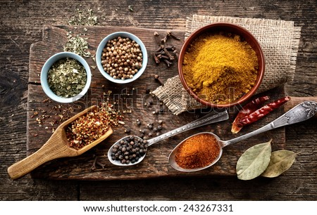 various spices on old wooden table - stock photo