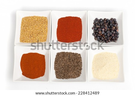various spices on white background