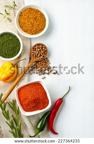 Various spices on white wooden background - stock photo