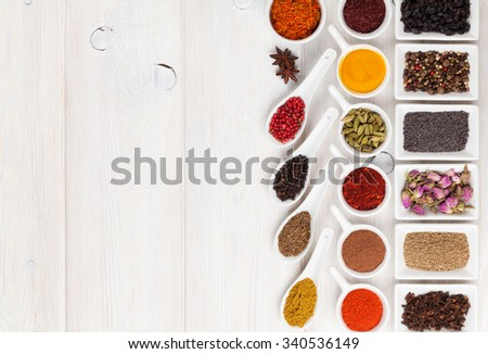 Various spices on white wooden background. Top view with copy space - stock photo