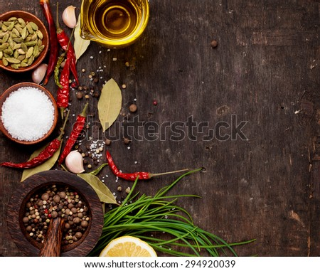 Various spices on wooden background. Top view with copy space - stock photo