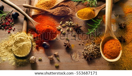 Various spices on wooden board. Top view