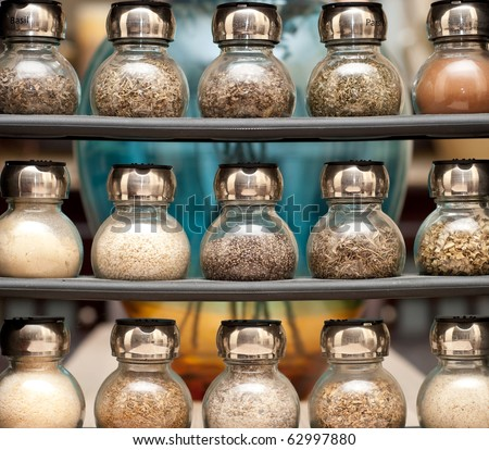 Various Spices on Wooden Rack - stock photo