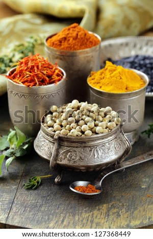 various spices (turmeric, paprika, saffron, coriander) in metal bowls - stock photo