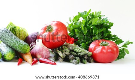 Various spring vegetables (asparagus, carrots, garlic, tomatoes, cucumbers)