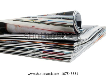Various stacked and rolled magazines - stock photo