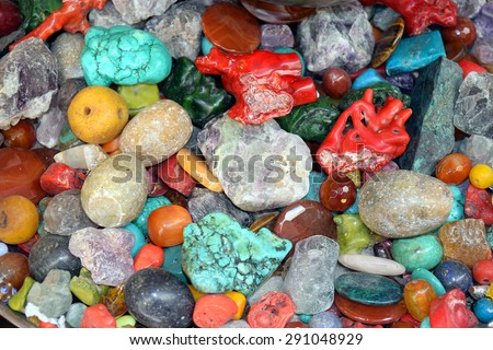 various stones, minerals, gems as natural background - stock photo