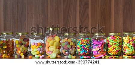 Various sugary candy in a glass jar - stock photo