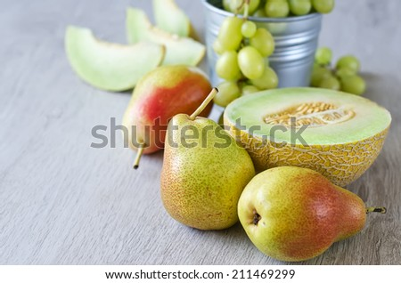 Various summer fruits, copy space background - stock photo
