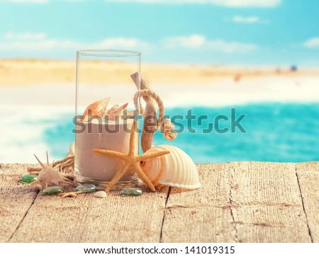 Various summer holiday items with blur beach on background - stock photo