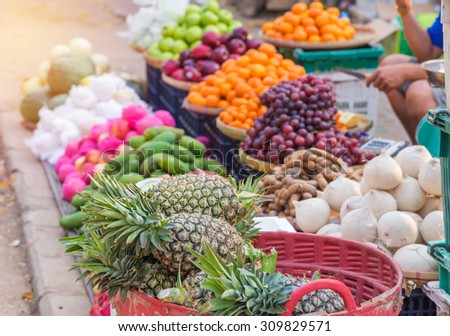 Various Sweet fruits for sale on the market. - stock photo