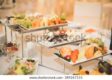 Various sweet sliced fruit on a buffet table