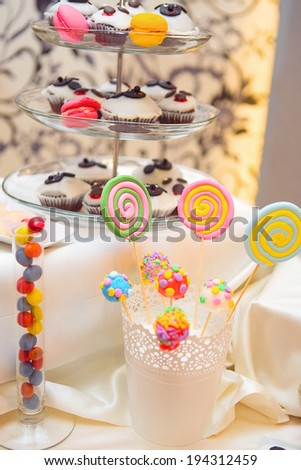 Various sweets sitting on a table during a party - stock photo