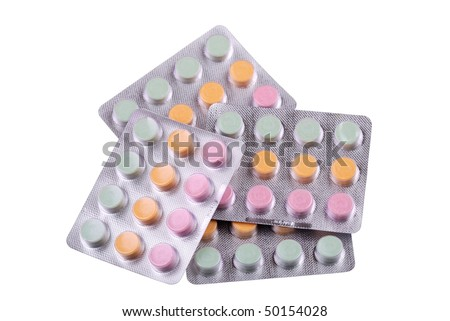 Various tablets and vitamins isolated on white - stock photo