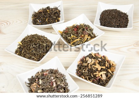Various tea in a white bowls - stock photo