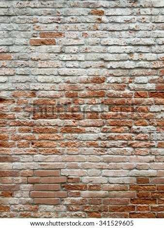 Various tone of white, orange and red bricks wall