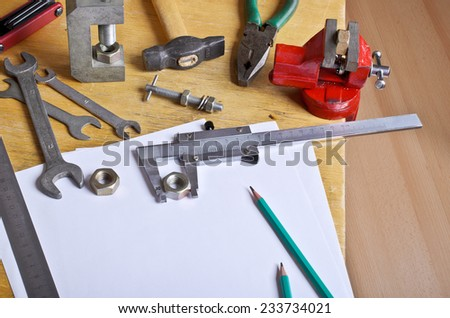Various tools and mechanical devices on the white blank sheets for recording - stock photo