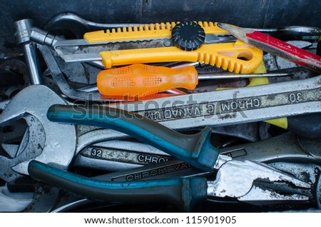 Various tools in a toolbox. - stock photo