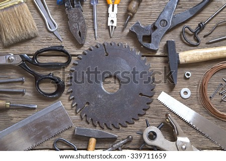 Various tools on a wooden background - stock photo