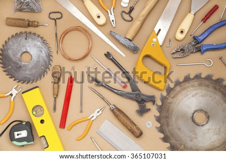 Various tools on cardboard background - stock photo