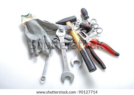 Various tools placed on a white background - stock photo
