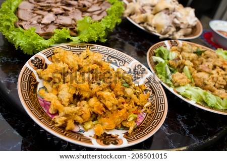 Various traditional chinese food is prepared on the table for chinese new year celebration