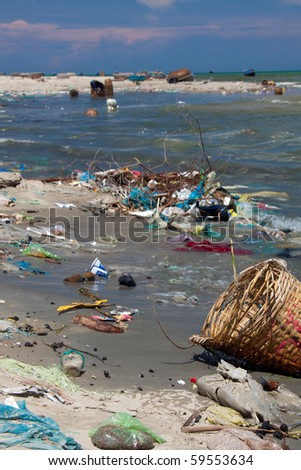 Various trash scattered along a coast - stock photo