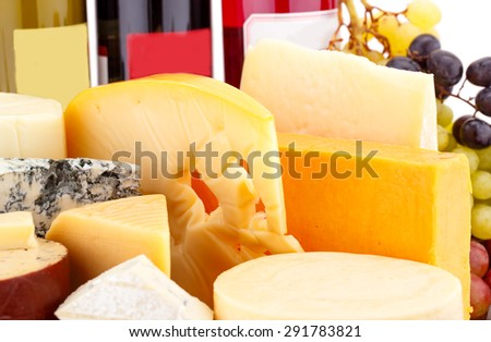 Various type of cheese,wines and grapes closeup picture. - stock photo