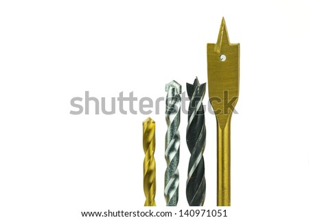Various type of drill bits over white background - stock photo