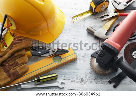 various type of tools on white textured background - stock photo