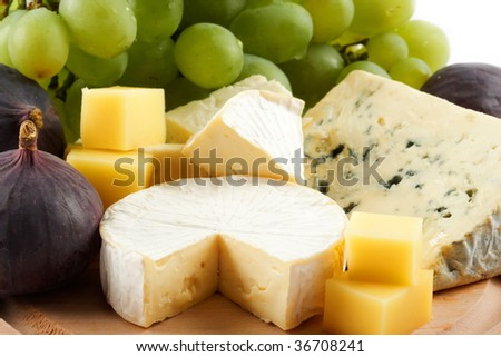 Various types of cheese and fruits